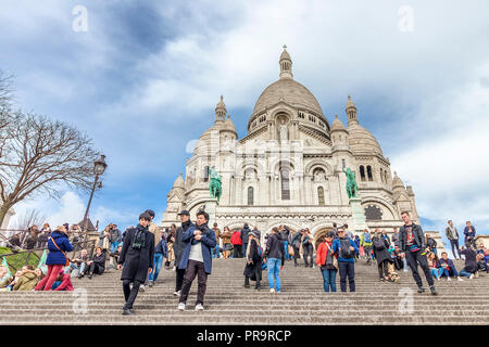 Paris, France - March 14, 2018:  The Basilica of the Sacred Heart of Paris is a Roman Catholic church and minor basilica, dedicated to the Sacred Hear - Stock Photo