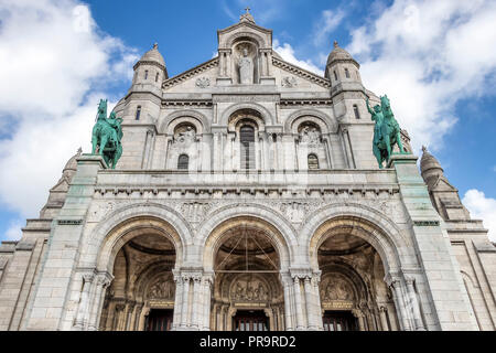 Facade of The Basilica of the Sacred Heart of Paris is a Roman Catholic church and minor basilica, dedicated to the Sacred Heart of Jesus, - Stock Photo