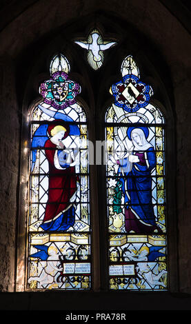 Stained glass depicting the Annunciation by the angel Gabriel to the Blessed Virgin Mary. St George Church Brinsop Herefordshire UK. September 2018. - Stock Photo
