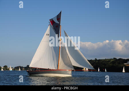 Traditional Falmouth working boat under sail in the Fal estuary - Stock Photo