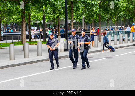 New York City, USA - June 8, 2017: Armed police officers patrol at a Manhattan street in New York City on June 8, 2017 - Stock Photo