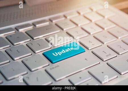 Update Button on Keyboard. Blue Color button on the gray silver keyboard of modern ultrabook. caption on the button - Stock Photo