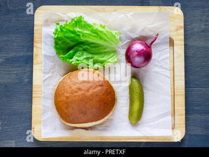 Ingredients for Burger bun, onion, lettuce and pickled cucumber  - Stock Photo