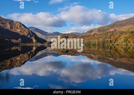 Reflections in Llyn Dinas in the Nant Gwynant valley near Beddgelert looking west with Moel Hebog and Moel Lefn in the background Snowdonia National P - Stock Photo