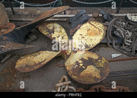 Propeller, rope, and chain lying on quayside near SS Great Britain, Bristol, UK - Stock Photo