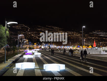 FUNCHAL, PORTUGAL - DECEMBER 7, 2016: Typical colorful Christmas lighting through the trees, streets, statues and buildings of Funchal City, Madeira, - Stock Photo