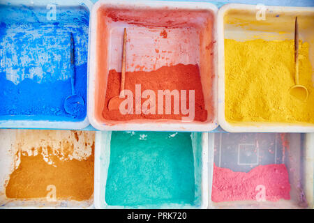 Multicolored pigment paints of different shades are sold on the streets of Morocco. Bright saturated colors of Morocco powder paints - Stock Photo