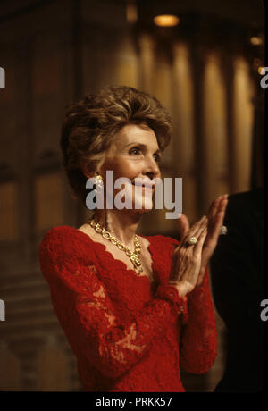 First Lady Nancy Reagan applauds President Reagan at a dinner to support Vice President HW Bush for his presidential race in May 1988.    Photograph by Dennis Brack bb24 - Stock Photo