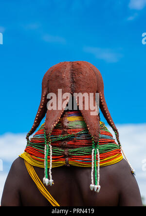 Rear view of a Mumuhuila tribe woman with an hairstyle in octopus shape, Huila Province, Chibia, Angola - Stock Photo