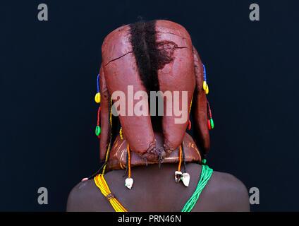 Rear view of Mumuhuila tribe girl hairstyle, Huila Province, Chibia, Angola - Stock Photo