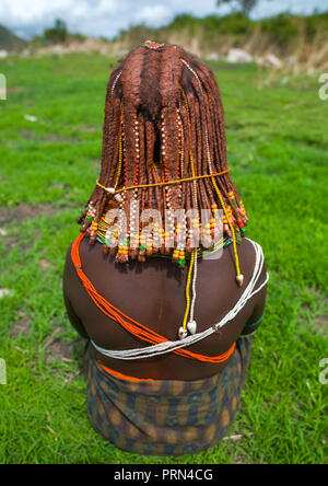 Rear view of a Mumuhuila tribe woman, Huila Province, Chibia, Angola - Stock Photo