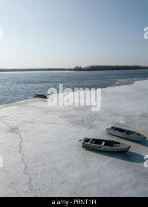 aerial view of river bank with boats covered with snow, Kyiv, Ukraine - Stock Photo
