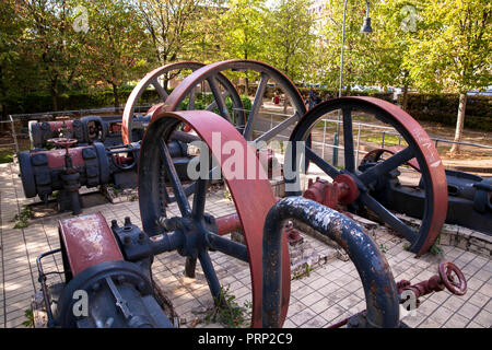 the flywheels of the refrigeration compressors of the former chocolate factory Stollwerck in the Suedstadt neighborhood, street Severinsmuehlengasse,  - Stock Photo