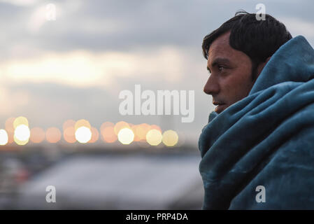 October 12, 2016 - Calais, France: Portrait of Bahram, a 32 year-old migrant from Afghanistan who lives in the Calais 'jungle' migrant camp. Scene de vie quotidienne dans la jungle de Calais, l'un des plus grands camps de migrants au monde. *** FRANCE OUT / NO SALES TO FRENCH MEDIA *** - Stock Photo