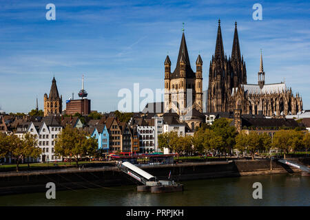 View of the historic centre, old town of Cologne with the river Rhine, the historic town hall, church of Great St Martin and Cologne Cathedral - Stock Photo
