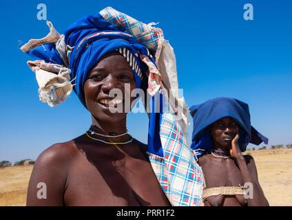 Mucubal tribe women wearing blue headwears, Namibe Province, Virei, Angola - Stock Photo