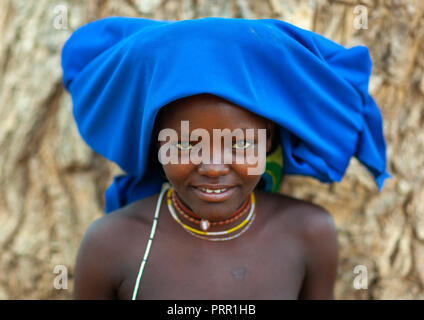 Mucubal tribe young woman wearing a blue headwear, Namibe Province, Virei, Angola - Stock Photo