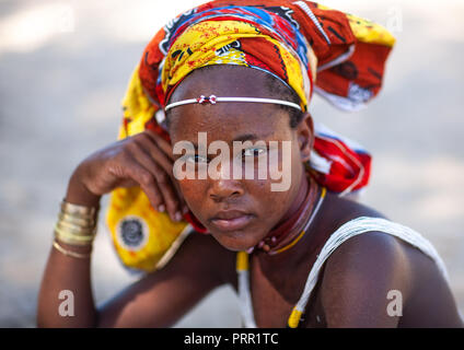 Portrait of a Mucubal tribe young woman wearing a colorful headwear, Namibe Province, Virei, Angola - Stock Photo
