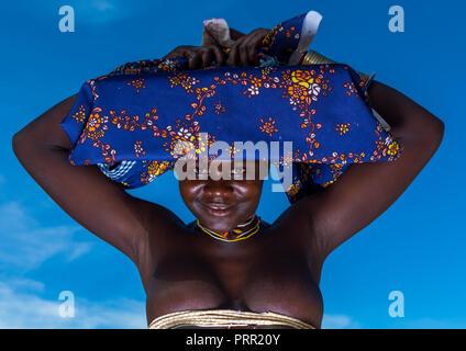 Mucubal tribe woman wearing a colorful headwear, Namibe Province, Virei, Angola - Stock Photo