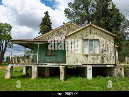 Portuguese settlers wooden houses, Huila Province, Lubango, Angola - Stock Photo