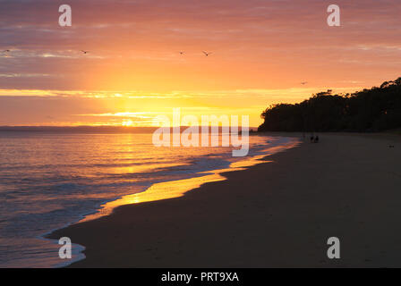 Sunset Over the Beach at Hervey Bay, Qld. - Stock Photo