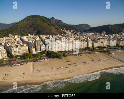 The famous Copacabana beach in Rio de Janeiro. Brazil South America. Christ the Redeemer mountain in the background. - Stock Photo
