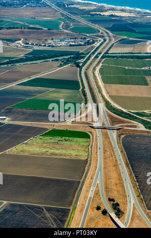 Pacific coast of California with farmland around freeway 101 and Monterey Bay visible in the up right corner. The picture was taken in the early July. - Stock Photo