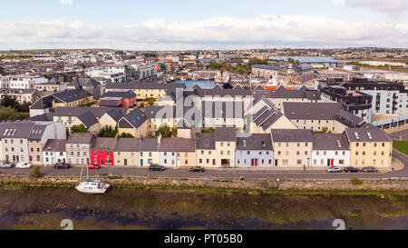 An aerial view across the River Corrib, towards the street known as The Long Walk in Galway, Ireland. - Stock Photo