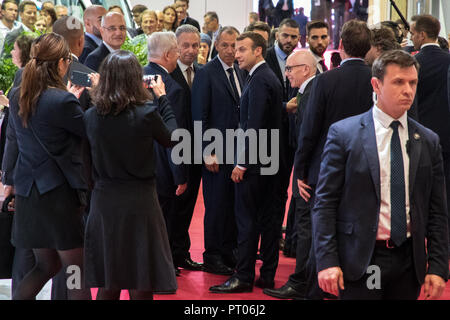 PARIS - OCT 3, 2018: President of France Emmanuel Macron visiting the Paris Motor Show 2018 edition. - Stock Photo