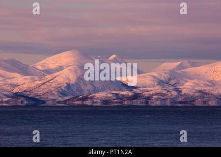 Fata Morgana mirage on a fjord near Tromso with Senja island mountains in background, Tromso, Troms, Norway, Europe - Stock Photo