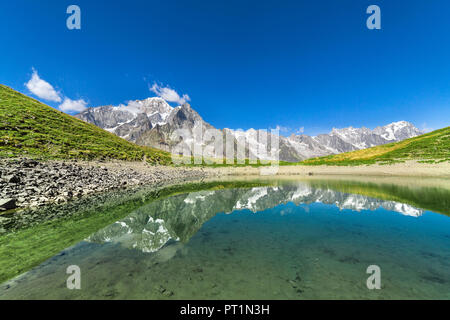 The Mont Blanc Massif reflected in the Checrouit Lake during the Mont Blanc hiking tours (Veny Valley, Courmayeur, Aosta province, Aosta Valley, Italy, Europe) - Stock Photo