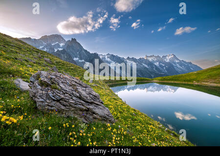 The Mont Blanc Massif reflected in the Checrouit Lake at sunset during the Mont Blanc hiking tours (Veny Valley, Courmayeur, Aosta province, Aosta Valley, Italy, Europe) - Stock Photo