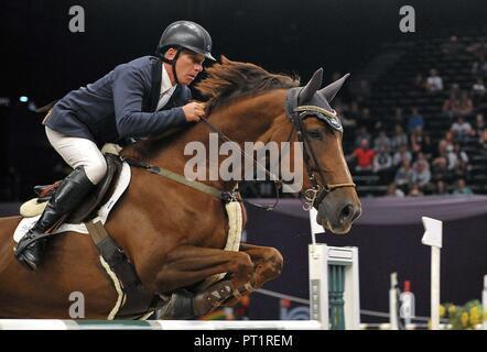 Birmingham, UK. 5th October, 2018. Mennell Watson (GBR) riding 'Fenix'. International showjumping. Grandstand welcome stakes. Horse of the year show (HOYS). National Exhibition Centre (NEC). Birmingham. UK. 05/10/2018. Credit: Sport In Pictures/Alamy Live News - Stock Photo