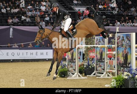 Birmingham, UK. 5th October, 2018. Peter Maloney (IRL) riding 'Victoria'. International showjumping. Grandstand welcome stakes. Horse of the year show (HOYS). National Exhibition Centre (NEC). Birmingham. UK. 05/10/2018. Credit: Sport In Pictures/Alamy Live News - Stock Photo