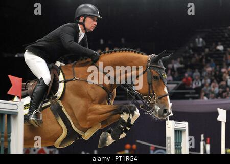 Birmingham, UK. 5th October, 2018. Richard Howley (IRL) riding 'Dolores'. International showjumping. Grandstand welcome stakes. Horse of the year show (HOYS). National Exhibition Centre (NEC). Birmingham. UK. 05/10/2018. Credit: Sport In Pictures/Alamy Live News - Stock Photo