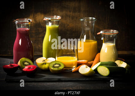 Various smoothies, fruits and vegetables - Stock Photo