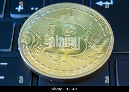 Golden bitcoin on keyboard. Digital currency concept - Stock Photo