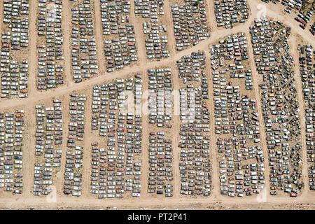 USA, Aerial of a car junkyard in Eastern Colorado - Stock Photo
