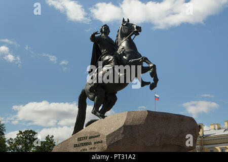 Equestrian monument to Peter the Great also known as the Bronze Horseman by French sculptor Étienne Maurice Falconet (1782) in Senate Square in Saint Petersburg, Russia. Inscription in Russian means: To Peter the First from Catherine the Second in the year of 1782. - Stock Photo