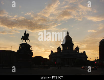 Saint Isaac's Cathedral designed by French architect Auguste de Montferrand and the equestrian monument to Tsar Nicholas I of Russia designed by Russian sculptor Peter Clodt von Jürgensburg (Pyotr Klodt) in Saint Isaac's Square in Saint Petersburg, Russia, pictured at sunset. - Stock Photo