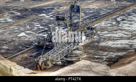 Drilling in the brown coal opencast mine Garzweiler of the RWE near Grevenbroich, Rhenish brown coal field, North Rhine-Westphalia, Germany - Stock Photo
