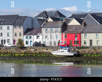 GALWAY, IRELAND - AUGUST 3, 2018: View from the Claddagh Basin, across the River Corrib, towards the street known as The Long Walk in Galway, Ireland. - Stock Photo