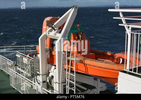 Life boat on Caledoniam MacBrayne Calmac ferry travelling at sea from Stornoway to Ullapool in the Outer Hebrides west coast Scotland - Stock Photo