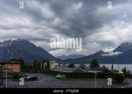 Europe, Italy, Varenna, Lake Como, a group of clouds in front of a mountain - Stock Photo