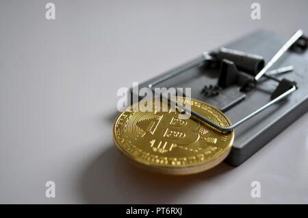 Bitcoin caught in a mouse trap - Stock Photo