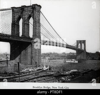A late 19th or early 20th century black and white photograph of the Brooklyn Bridge in New York, USA. - Stock Photo