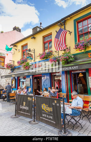 GALWAY, IRELAND - AUGUST 18, 2012: Men relaxing on a summer's day at The Quays bar in Shop Street in Galway,  Ireland. - Stock Photo