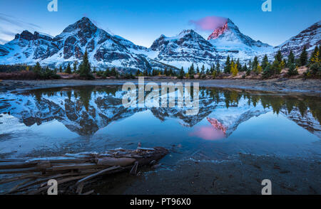 Mount Assiniboine, also known asAssiniboine Mountain, is apyramidal peakmountainlocated on theGreat Divide, in British Columbia/Alberta. - Stock Photo