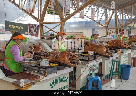 Hornados or pig roast Gualaceo indoor market nr Cuenca Ecuador - Stock Photo