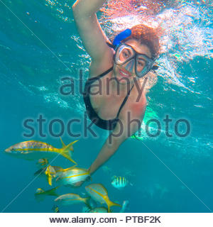 Varadero Beach, Cuba: A woman snorkeling on the in open sea in the transparent water of the famous tourist attraction - Stock Photo